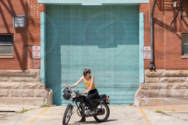 Irreverent female motorcycle city bold standout  photo