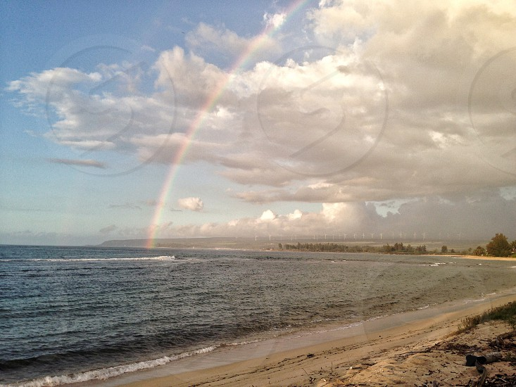 Rainbow over Haleiwa Bay on the North Shore of Oahu in Hawaii photo
