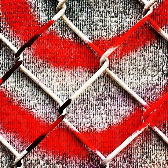 white and red metal fence photo