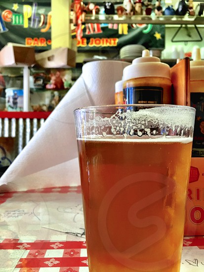Glass of beer on restaurant table.  photo