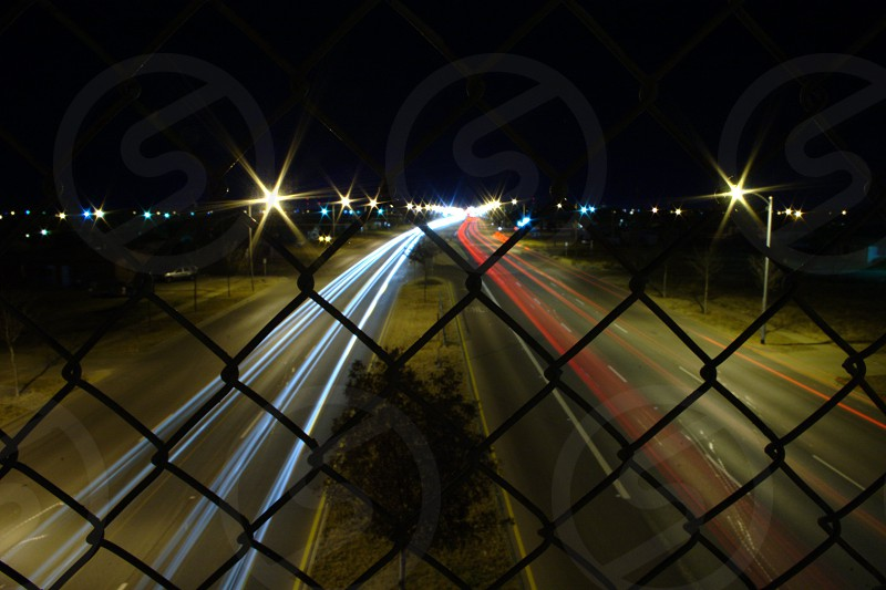 time lapse photo of vehicles passing on highway during night photo