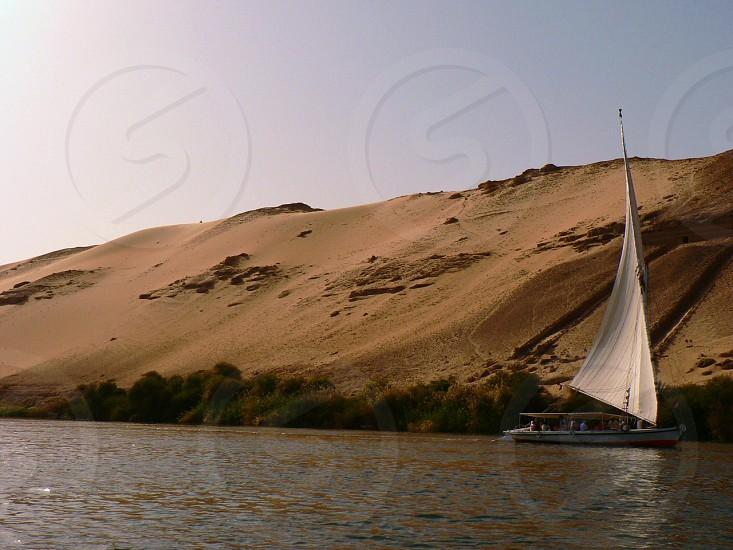 white sail boat on sea photo