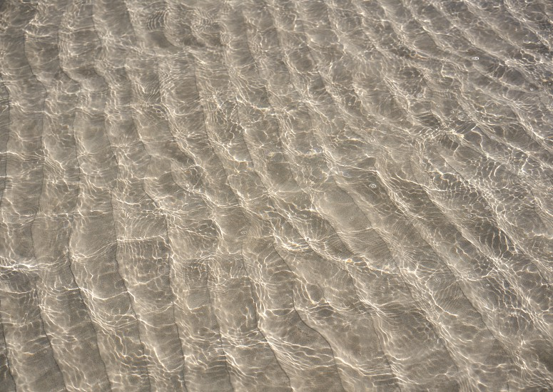 Caribbean transparent water beach reflections in shallow white sand bottom photo