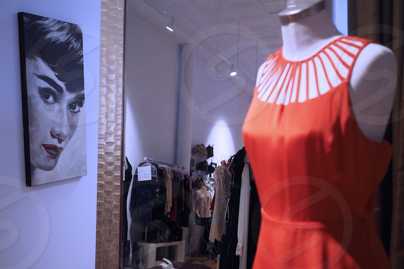 Mannequin in dress shop vivid coral fabric high fashion    photo