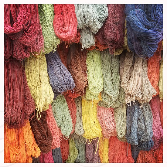 assorted colors of yarn photo