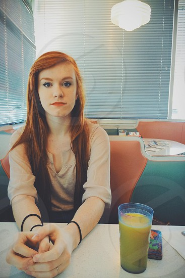 Katie sitting at Jay's Diner in Rochester NY. photo
