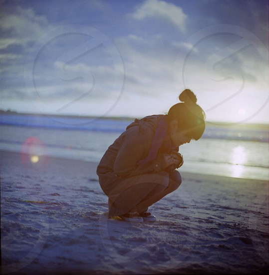 woman sitting near the sea  photo