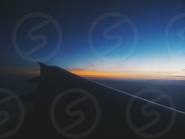 aeroplane sunset view high fly flight beautiful landscape wings photo
