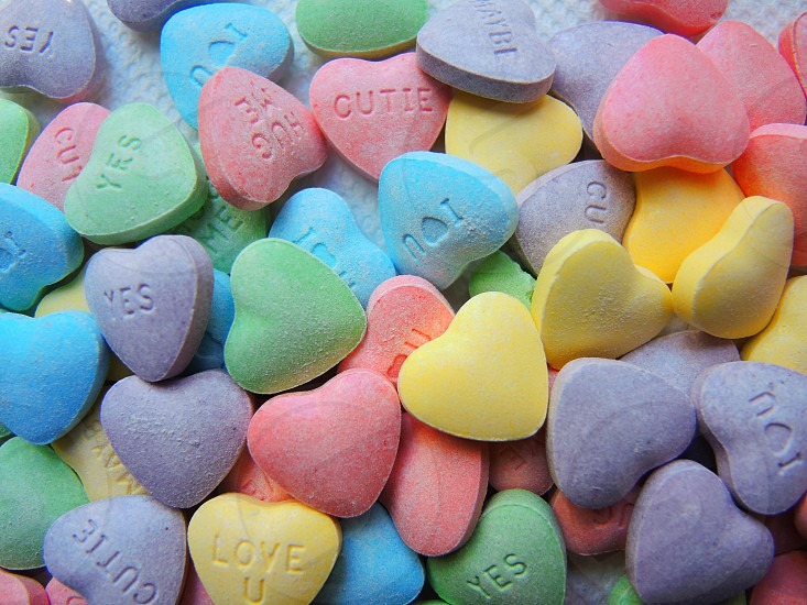yellow purple and blue heart candies photo