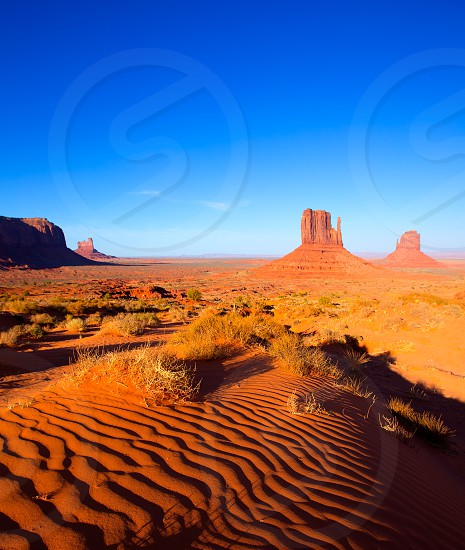 Monument Valley West and East Mittens Butte desert sand dunes Utah photo
