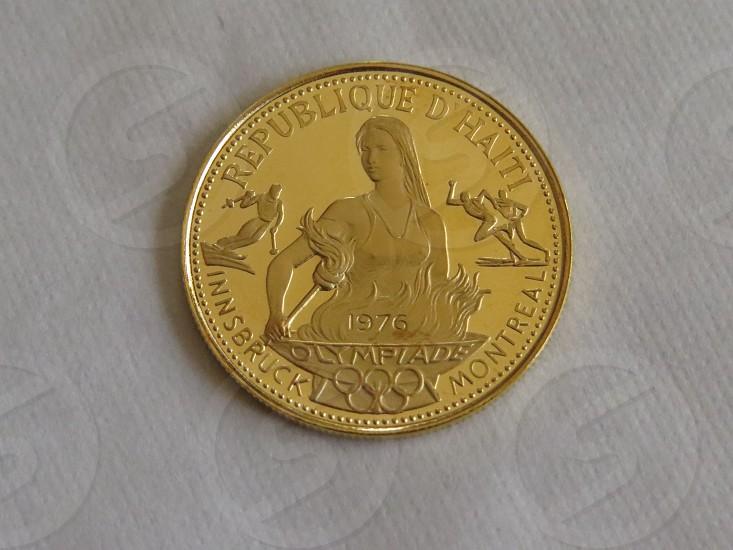 Gold coin Olympics Haiti photo