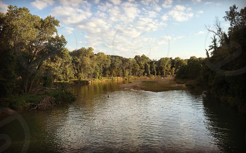 River Missouri riverbank clouds Sky trees photo