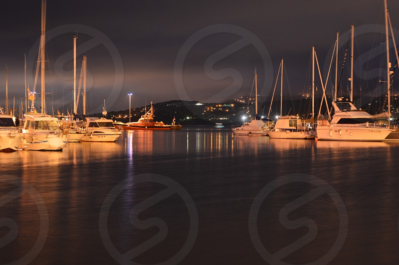 7 white yacht parked during night photo