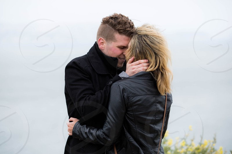 couple flowers golden gate bridge sf san francisco ocean relationship hair wind cold happy proposal wedding  photo