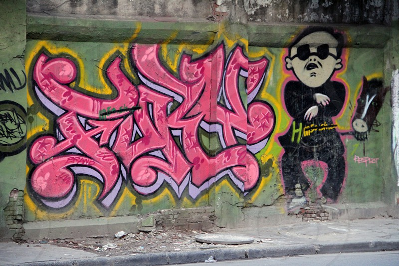 Street graffitti related to music with drawing of Gagnam style singer PSY in Moganshan Lu m50 Shanghai China. photo