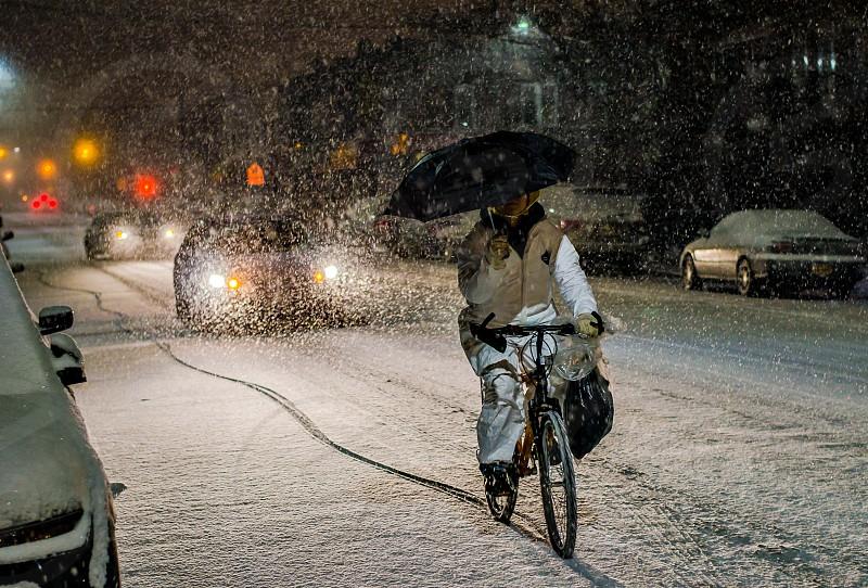 Snow storm storm bicycleriderwinter umbrella photo