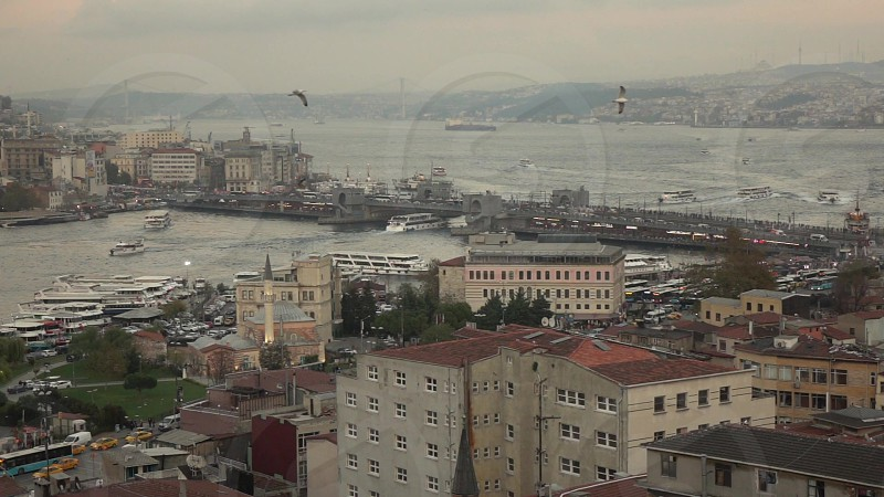 Panoramic Istanbul cityscape of Bosphorus with marine traffic Galata bridge and building on a cloudy sunset background. Slow motion Full HD video 240fps 1080p. photo