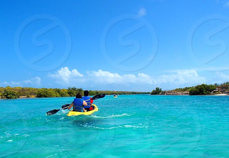 kayakyellowblue waterpaddlepaddlingblue sky vacation photo