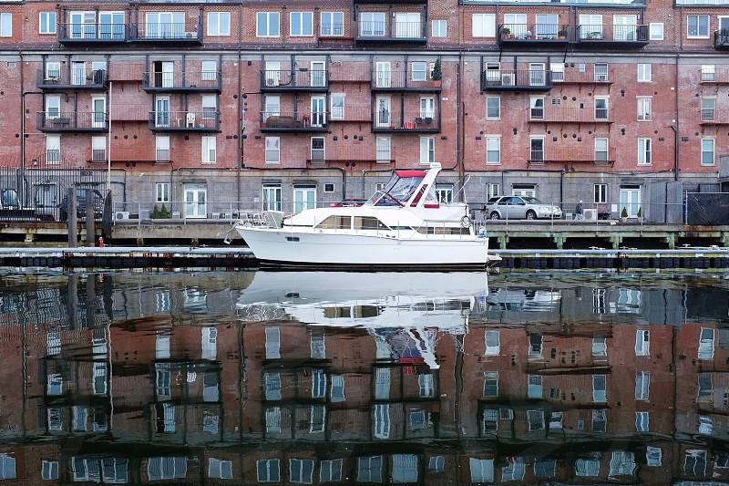 white yacht on dock photo