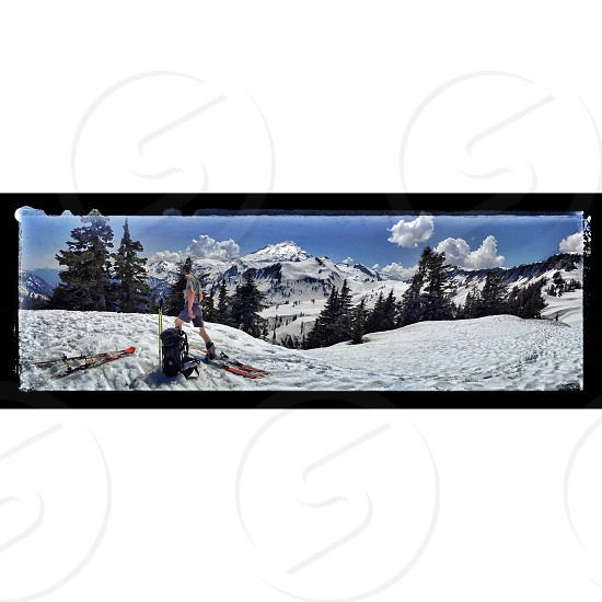 person doing snowboarding standing on snow filed in panoramic photo photo