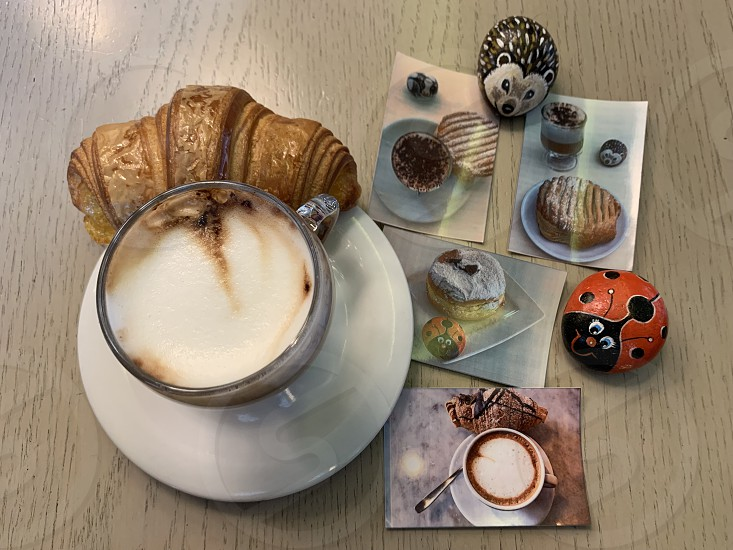Coffee with milk cup with travel memories on instant pictures photo