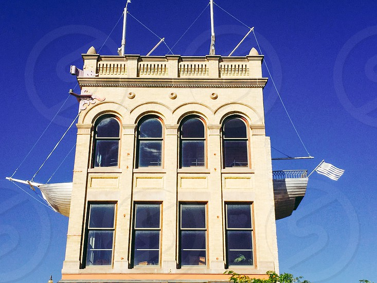Ship in a building. Blue sky  photo