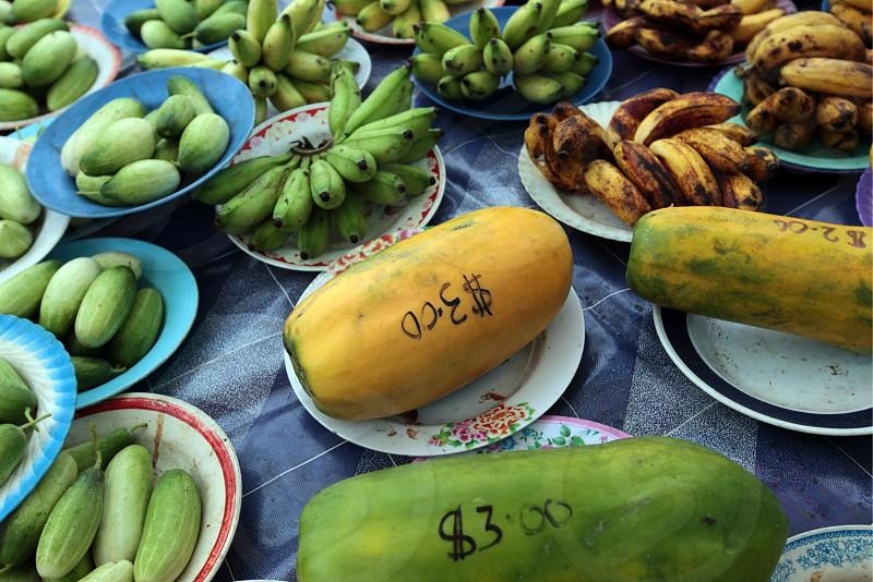 ASIA BRUNEI BORNEO BANDAR SERI BEGAWAN DARUSSALAM FOOD MARKET  PLATE PORTIONS ASIA FOOD FRUIT FRUIS TROPICAL FRUITS MARKET FRUIT MARKET PAPAYA ASIAN FRUIT photo