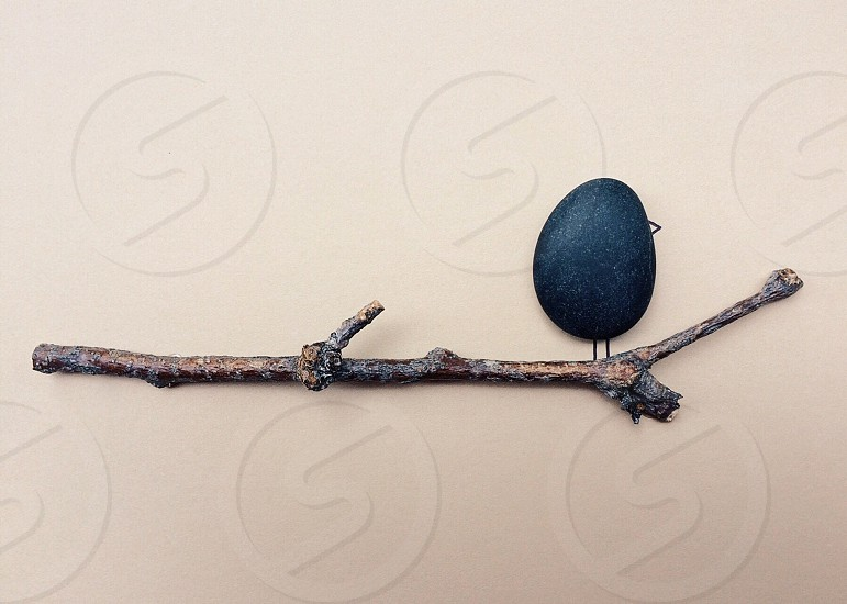 black stone with wood stick photo