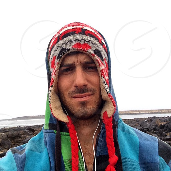 man in blue buffalo check zip hoodie and nordic winter hat photo
