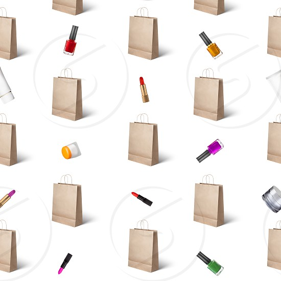 pattern from female cosmetics lipstick  nail polish cream and paper bags on a beige background photo