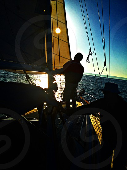 Raising the sails sailing Puget Sound sailboat photo
