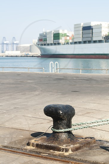 Ship moored to pier view from bollard photo