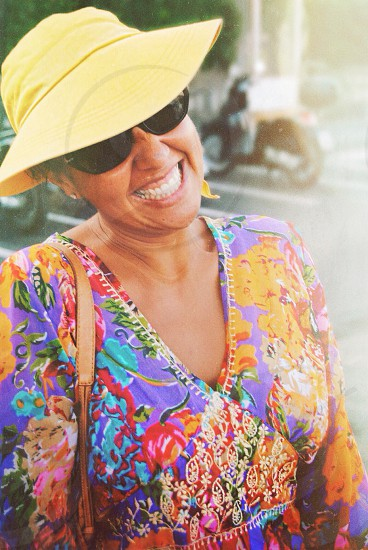 woman in floral printed dress smiling photo