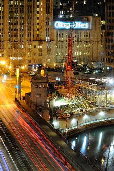 Chicago night streetlights streaks water river bridge construction  photo