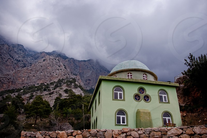 A mosque in the mountains on a foggy day. photo