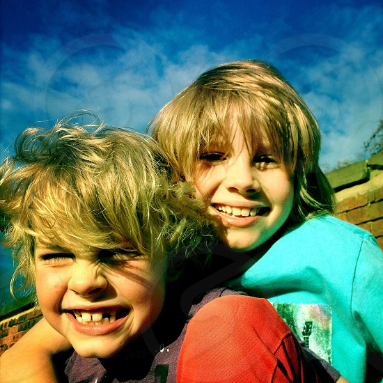 two kids smiling photo