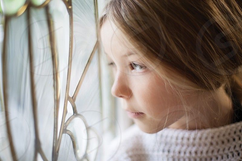 Child looking out window photo