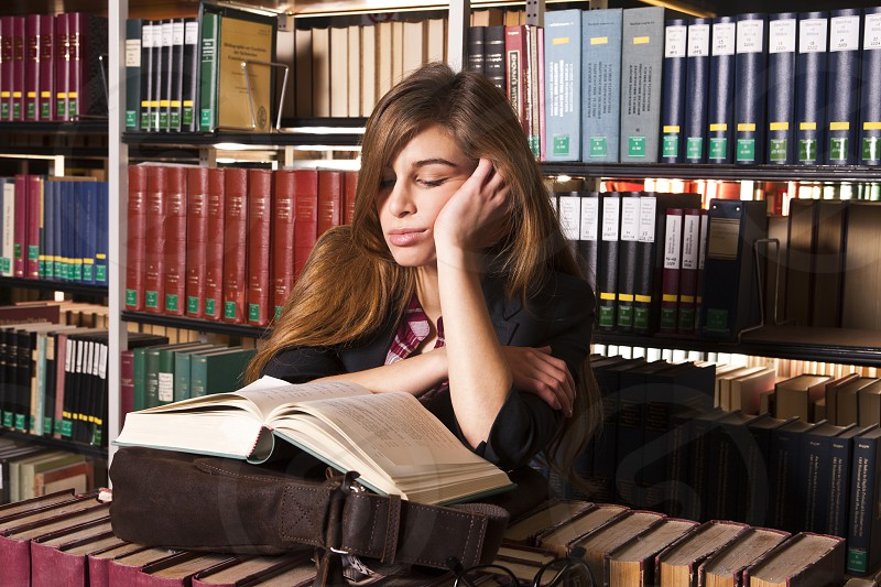 Information; Overwhelmed; Knowledge; Horizontal; Looking At Camera; Indoors; Book; Head And Shoulders; Brown Hair; Textbook; Caucasian Ethnicity; Sitting; Adult Student; Belgium; Studying; Library; Brussels; One Person; Learning; Adult; Young Adult; Working Late; Color Image; Women; One Young Woman Only; Only Women; One Woman Only; Portrait; Photography; Mature Student; University Student; Student; Capital Cities; Stacking; Responsibility; Adults Only; Self Improvement; Preparation photo