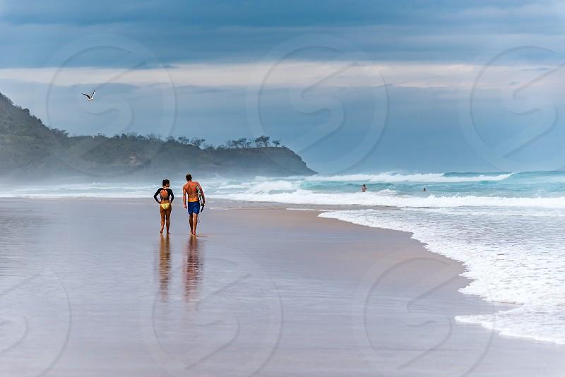 Surfers at sunshine beach in Noosa Australia photo