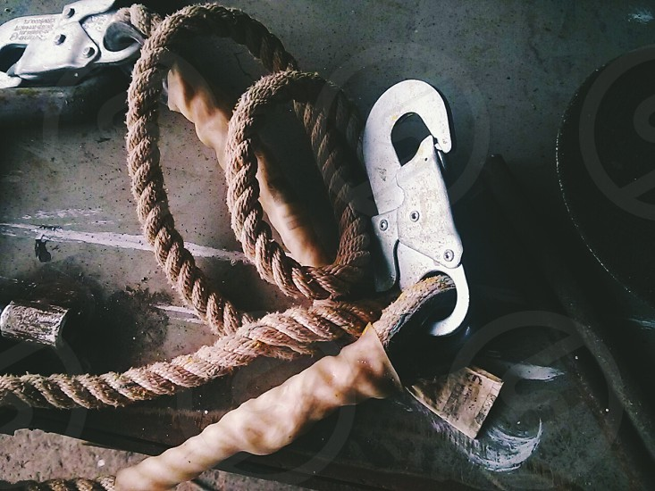 brown rope with gray steel hooks photo