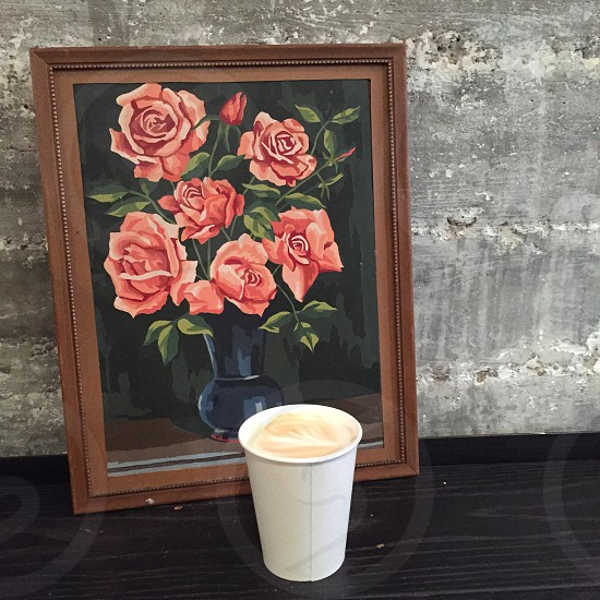 framed artwork rose painting white paper cup with brown liquid photo