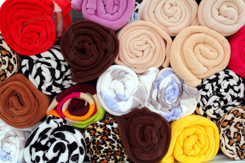 colorful towel shop stacked in rolled rows like blankets photo