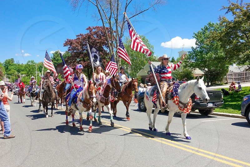 Memorial Day parade 2019 in Lenox Ma. Horseback ridersand flags waving. photo