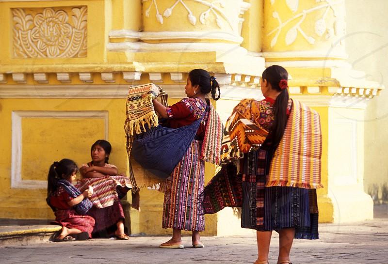 indio women at the church senora de la nerced in the old town in the city of Antigua in Guatemala in central America.    photo