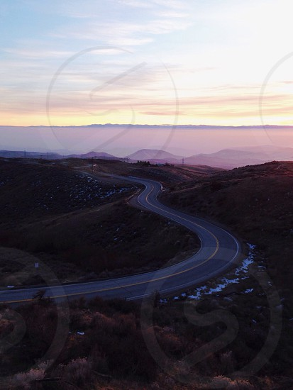 A road in Idaho in the mountains at sunset. photo