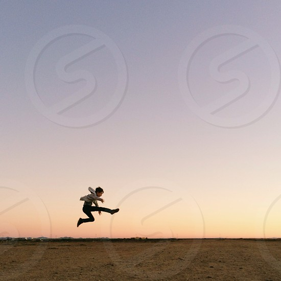 boy jumping photo
