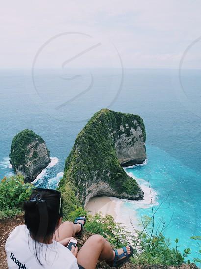 Looking down to the beautiful scene below in Nusa Penida island Bali Indonesia photo