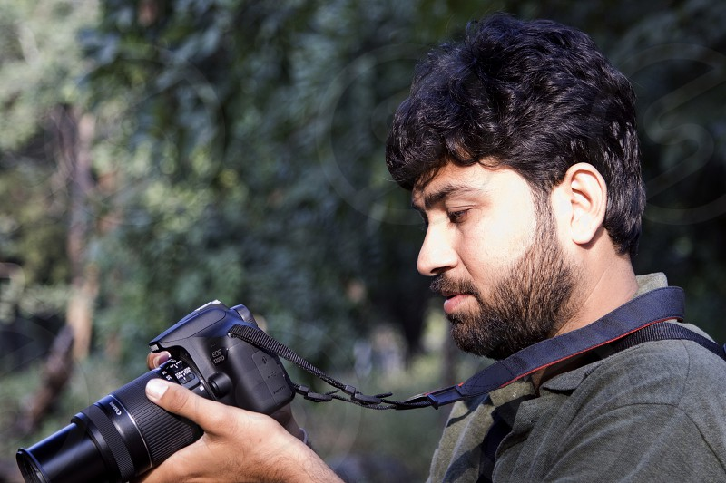 a man with DSLR photo