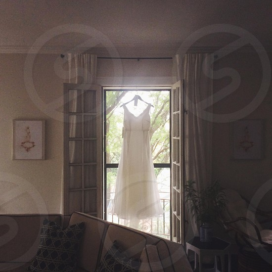 A wedding dress hanging before the ceremony. photo