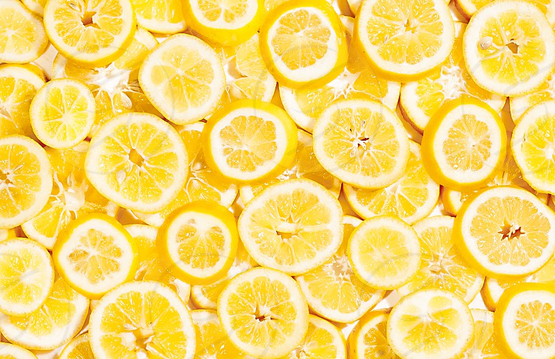 A full frame of bright yellow lemon slices. photo